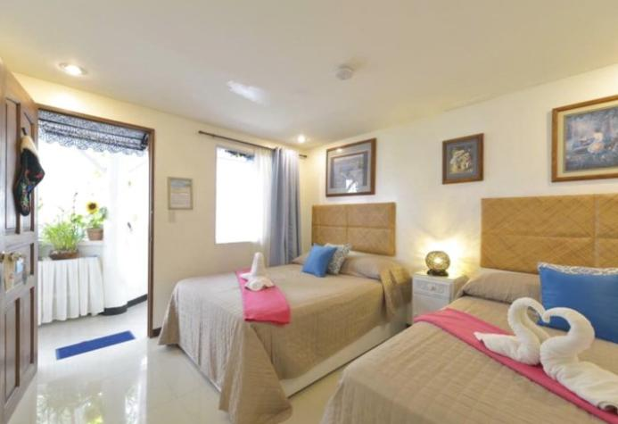 长滩岛蓝色阳台套房酒店